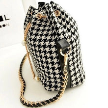 houndstooth drawstring bag with pearls on chain side view edgability