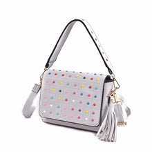 multicoloured studded white bag with tassles angle view edgability