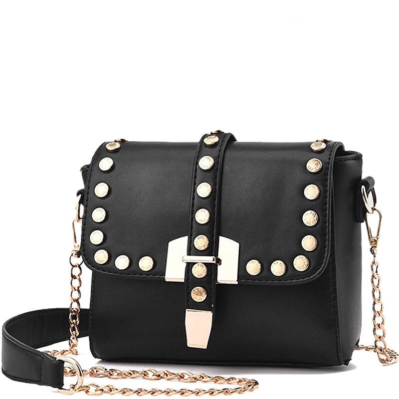 boxy gold studded black bag with chain edgability