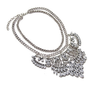 side view silver metal and crystals statement necklace edgability