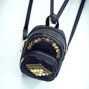 gold studs on black mini backpack top view edgability