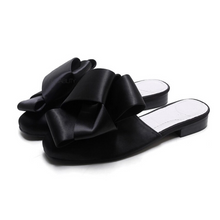 classy bow black flats angle view edgability