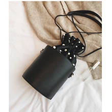 pearl studded black drawstring bag edgability top view