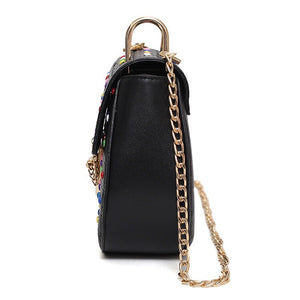 multicoloured studded bag black bag edgability side view