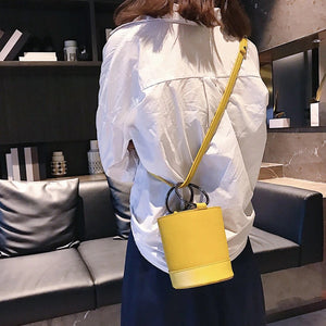 yellow bag bucket bag minimalist fashion edgability model view
