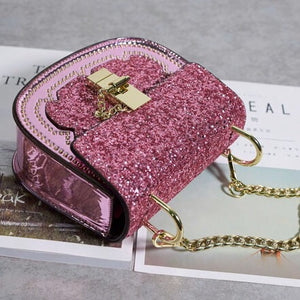 sparkly pink party handbag angle view edgability