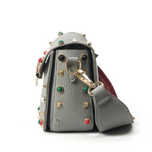 multi coloured studded sling bag side view edgability