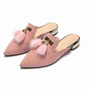 fur tassles on sandy pink flats angle view