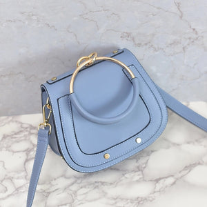 chic studded bag blue wristlet edgability top view