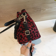 leopard print red bag drawstring bucket bag edgability side view