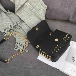 black bag studded bag with gold rivets edgability open view