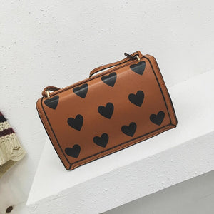 hearts tan bag trendy bag edgability back view