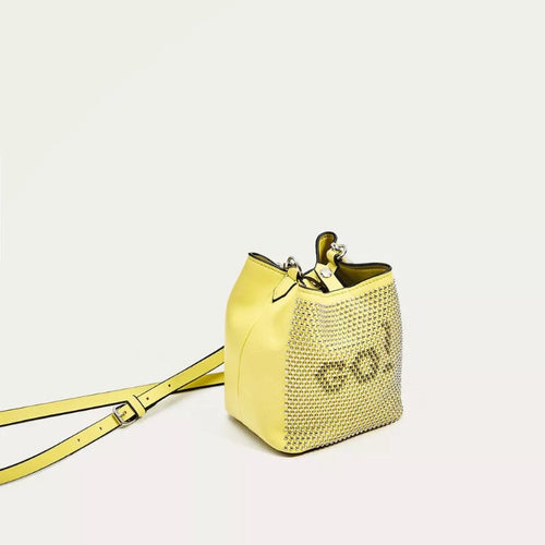 graphic studded yellow sling bag angle view edgability