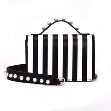 striped black bag studded bag edgability