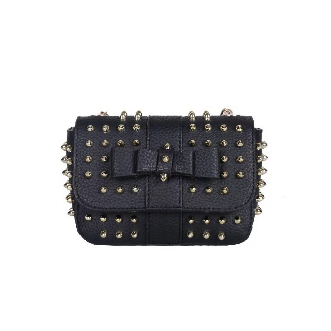 black bag studded bag with gold rivets edgability
