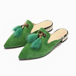 fur tassles on green flats angle view