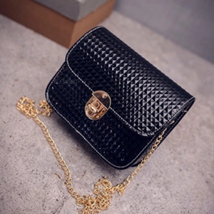 small black purse with rivet texture edgability