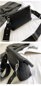black clutch bag with safety pin edgability angle view
