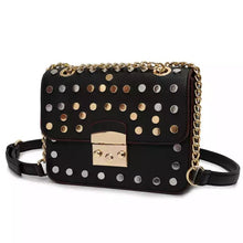 silver gold studded bag black bag edgability angle view