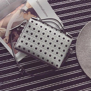 grey silver studded bag edgability top view