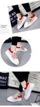 red white sneakers with hands edgability detail view