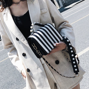 striped black bag studded bag edgability model view