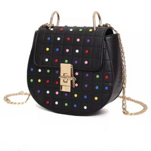 multicoloured studded bag black bag edgability angle view