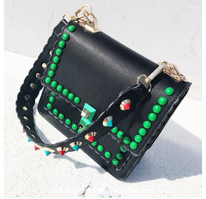 green rivets black studded bag edgability top view