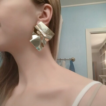 gold earrings statement jewelry edgability model view