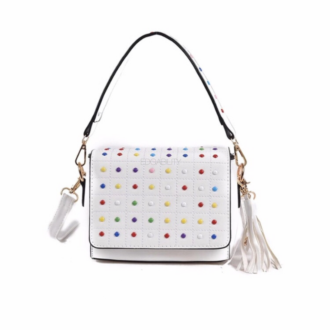 multicoloured studded white bag with tassles edgability