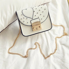 silver spikes studded heart offwhite bag model view edgability