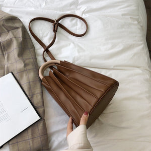 pleated bucket bag brown bag edgability top view