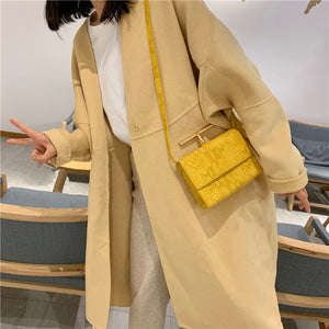 snakeskin envelope yellow clutch bag edgability model view