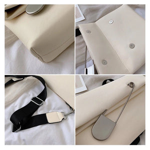 white clutch bag with safety pin edgability detail view