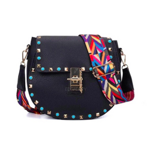studded black sling bag with colourful strap edgability