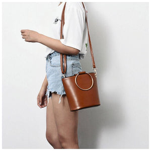 brown bucket bag with ring handle edgability model view