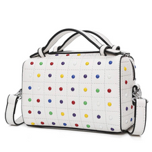 studded bag in white edgability angle view