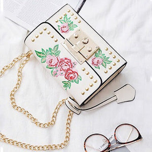 studded bag floral bag edgability top view