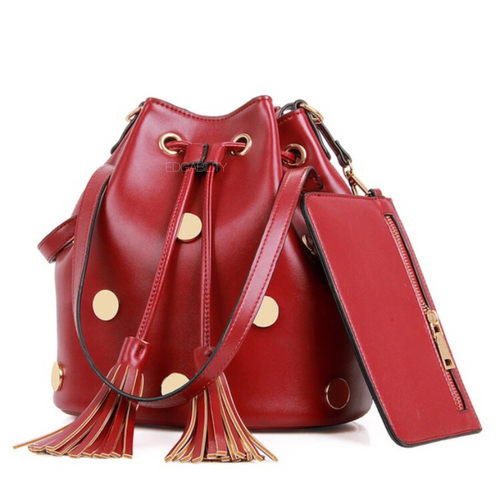 gold studded red drawstring bag with tassles edgability