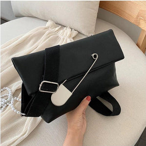 black clutch bag with safety pin edgability model view