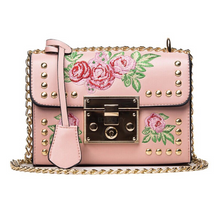 pink embroidered studded bag edgability