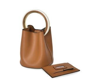 tan bag bucket bag luxury bag wristlet edgability angle view