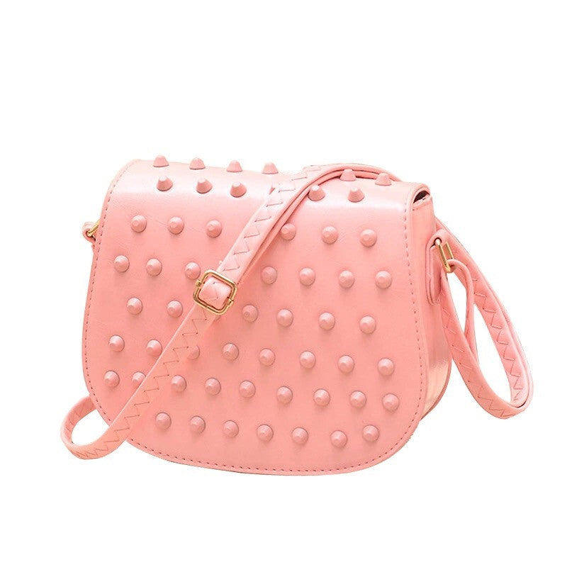 peach sling bag with monotonous studs edgability
