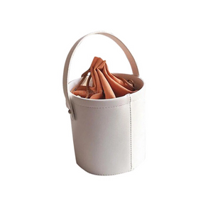 pom pom white bucket bag angle view edgability