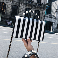striped black bag studded bag edgability front view