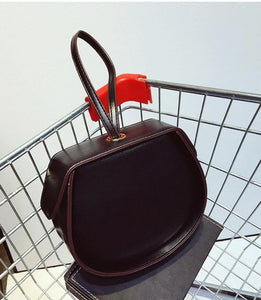 black bag box bag round bag wristlet edgability top view