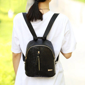 black mini backpack croc skin bag edgability model view