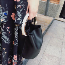 black bag bucket bag luxury bag wristlet edgability model view