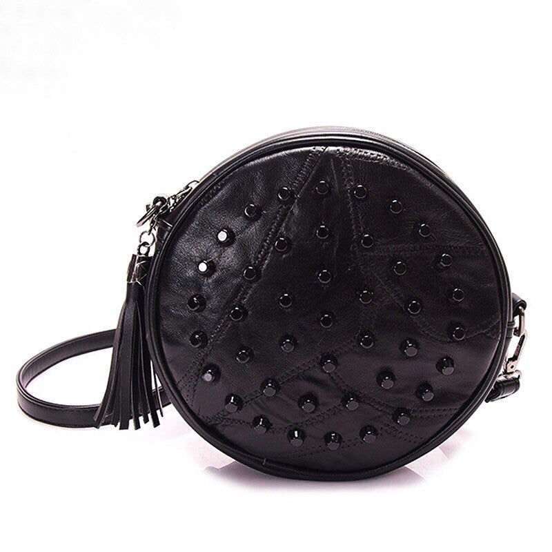 studded black round bag with tassles edgability