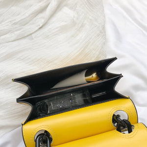 croc skin yellow sling bag with black strap edgability inside view